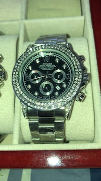 round black chronograph watch with silver link bracelet Brampton, L6T