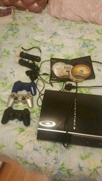 black Sony PS3 console with controller and game ca Greater London