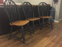 Three black-and-brown wooden windsor chairs Islip, 11706
