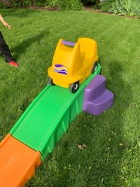 toddler's green and yellow plastic toy car