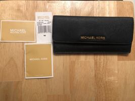 Michael Kors black (authentic) leather wallet with tag