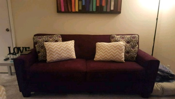 Plum Colored Sofa With Throw Pillows