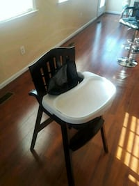 white and black wooden high chair Gainesville