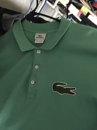 green and black polo shirt Houston, 77067