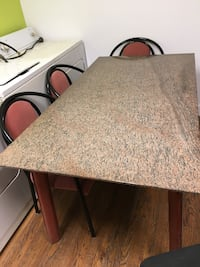 Pinkish marble top table with legs cover with leather