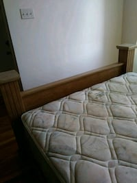 brown wooden bed frame with white mattress Montréal, H4H 1V9