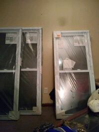 several assorted white wooden framed glass door pa