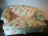white and pink floral fabric sofa