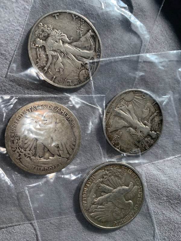 Four half dollar walking liberty coins 0f241696-7740-4cea-9320-7c319e807cd4