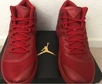 Pair of red air jordan melo 13 basketball shoes. been worn one time and are in brand new condition.