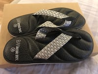pair of black-and-gray slide sandals Richmond Hill, L4C