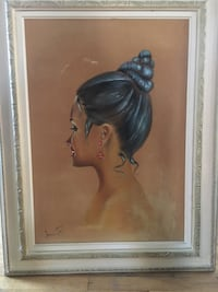 woman in blue dress painting with brown wooden frame Laval, H7K 3N5