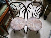 two brown padded chairs with black metal frames Mississauga