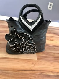 black leather with flowers hand bag ( new )  794 km
