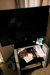 black flat screen TV with remote Fort Lauderdale, 33315