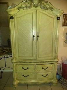 beige wooden armoire with two drawers