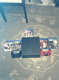 black Sony PS4 console with controller and game cases Brampton, L7A