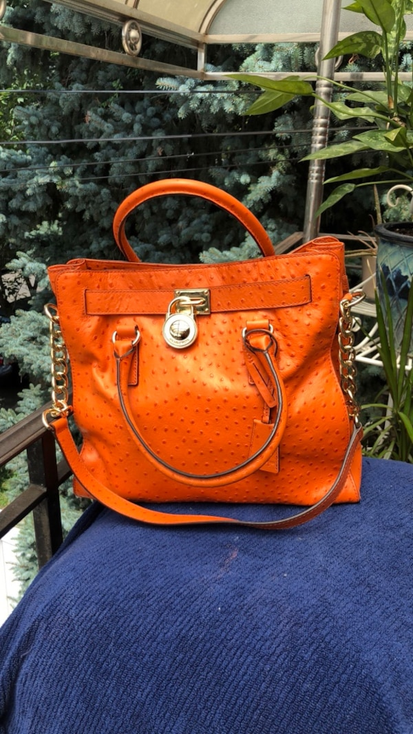 d6176c0e2f248a Used Women's Michael Kors orange ostrich leather tote bag for sale ...