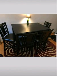rectangular brown wooden table with four chairs di Cambridge, 02140