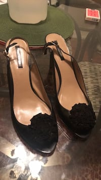 pair of women's black leather pumps 45 km