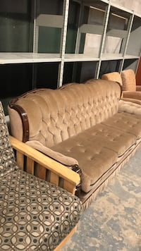 brown wooden framed brown padded couch