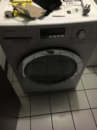 Stainless steel and gray bosch front load washing machine St. Louis, 63101