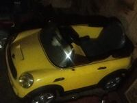 Yellow and black car toy 225 mi
