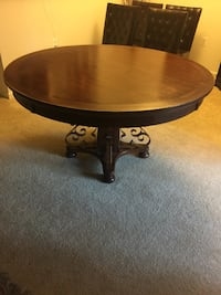 Round brown wooden pedestal table Mc Lean, 22102