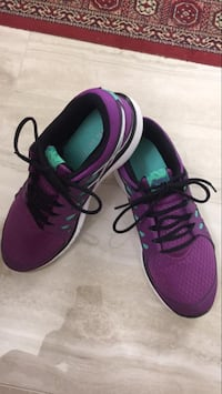 Pair of purple-and-teal low-top running shoes size 7.5 Frisco, 75035