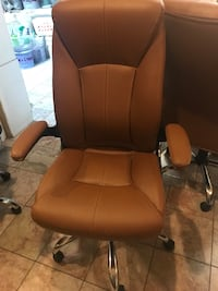 brown leather office rolling armchair 47 km