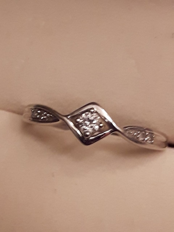diamond embellished silver-colored ring