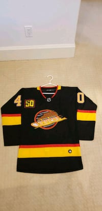 Canucks Pettersson Jersey Skate and Puck 50th Anniversary