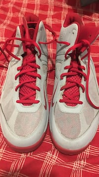pair of gray-and-red Nike running shoes Los Angeles, 90037