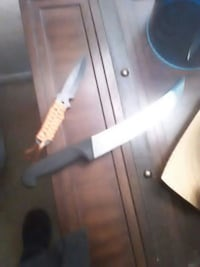 Swiss army dagger and UTS knife