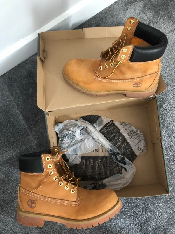 pair of brown Timberland work boots on box