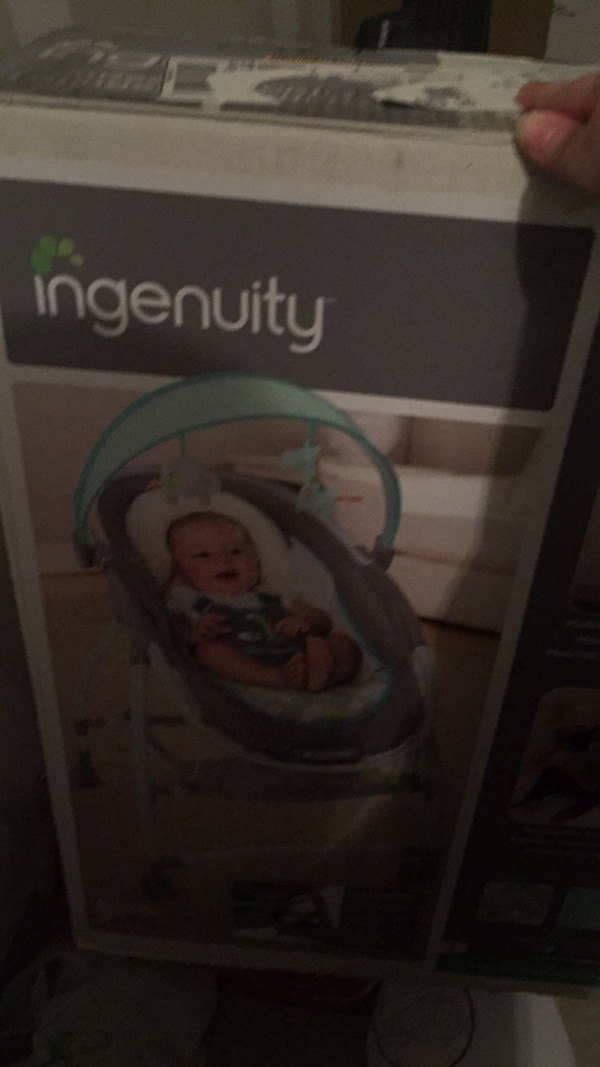 baby's white and blue cradle n swing