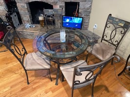 Glass table, 4 chairs, and bakers rack for sale