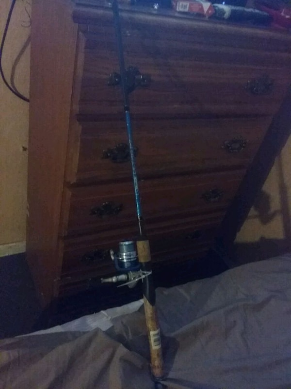 2 open faced fishing poles 9
