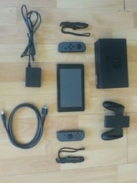 black Nintendo Wii console with controller Toronto, M8V
