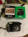 black Fujifilm instant camera with box