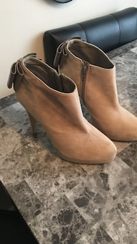 Pair of brown leather side-zip pump-heeled booties Central Okanagan, V4T 1P9