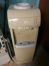 white and gray hot and cold water dispenser