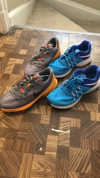 Two pairs of blue and gray nike running shoes