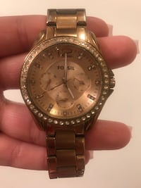 Round gold colored Fossil  watch with link bracelet West Covina