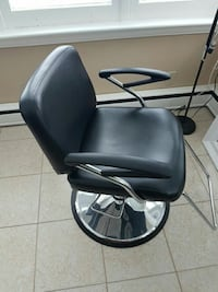 black leather padded rolling armchair London, N6C 2T2