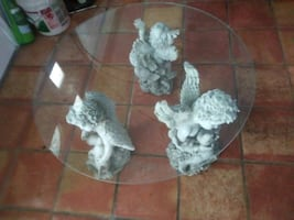Beautiful Angel Statues holding a glass top....  Table . /Coffee table