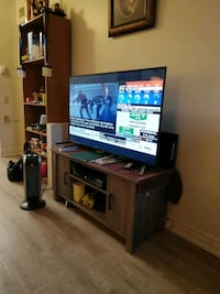 flat screen TV and black wooden TV stand 508 km