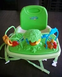 green and brown highchair with tray 28 km