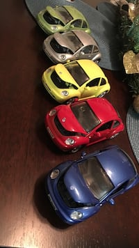 several assorted colored Volkswagen New Beetle scale model s