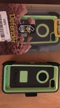 Two IPhone 5C Otterbox cases with belt buckle clip